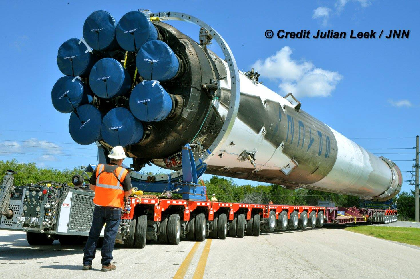 Up close view of base of recovered SpaceX Falcon 9 first stage rocket powered by 9 Merlin 1 D engines being transported horizontally back to SpaceX processing hanger at the Kennedy Space Center from Port Canaveral, Florida storage and processing facility on April 19, 2016. Credit: Julian Leek