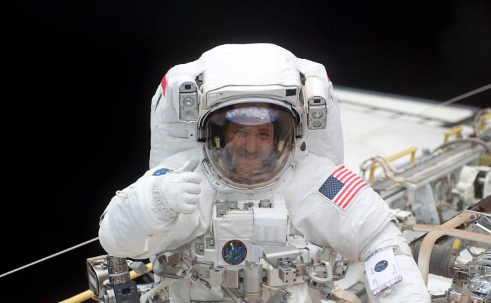 In this March 2002 image, John Grunsfeld, former astronaut and associate administrator of NASA's Science Mission Directorate, is shown in space shuttle Columbia's cargo bay during the STS-109 Hubble servicing mission.  Credits: NASA