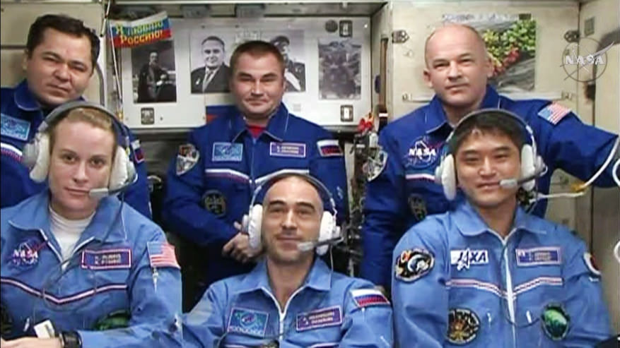 The new six-member Expedition 48 crew join each other for well wishes and congratulations from family, friends and mission officials. In front, from left, are the new crew members Kate Rubins, Anatoly Ivanishin and Takuya Onishi. In the back row are Flight Engineers Oleg Skripochka and Alexey Ovchinin and Commander Jeff Williams. Credit: NASA TV