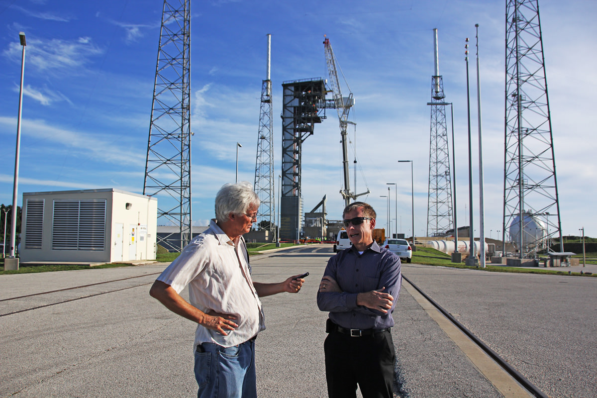 As the Boeing Starliner Crew Access Arm and White Room are bolted into place behind us at Space Launch Complex 41, Chris Ferguson, former shuttle commander and current Boeing deputy program manager for Commercial Crew, and Ken Kremer of Universe Today discuss the details and future of human spaceflight on Aug. 15, 2016 at Cape Canaveral Air Force Station.  Credit: Jeff Seibert