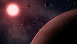 Artist's impression of a system of exoplanets orbiting a low mass, red dwarf star. Credit: NASA/JPL