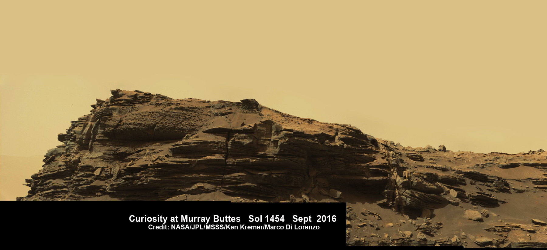 Dramatic closeup view of hillside outcrop with sandstone layers showing cross-bedding  in the Murray Buttes region on lower Mount Sharp from the Mast Camera (Mastcam) on NASA's Curiosity Mars rover. This photo mosaic is stitched and cropped from Mastcam camera raw images taken on Sol 1454, Sept. 8, 2016, with added artificial sky.  Credit: NASA/JPL/MSSS/Ken Kremer/kenkremer.com/Marco Di Lorenzo