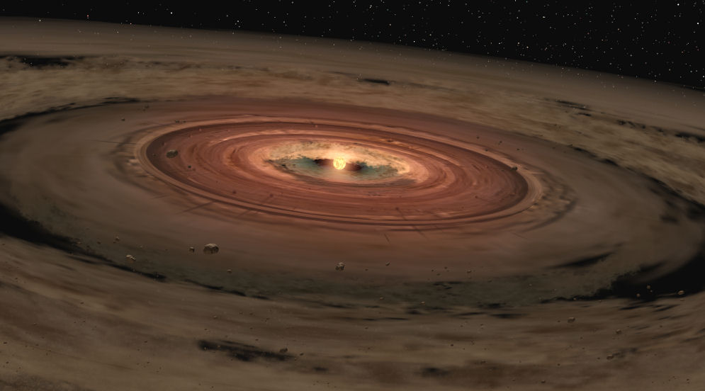 Planets coalescing out of the remaining molecular cloud the star formed out of. Within this accretion disk lay the fundamental elements necessary for planet formation and potential life. Credit: NASA/JPL-Caltech/T. Pyle (SSC) - February, 2005