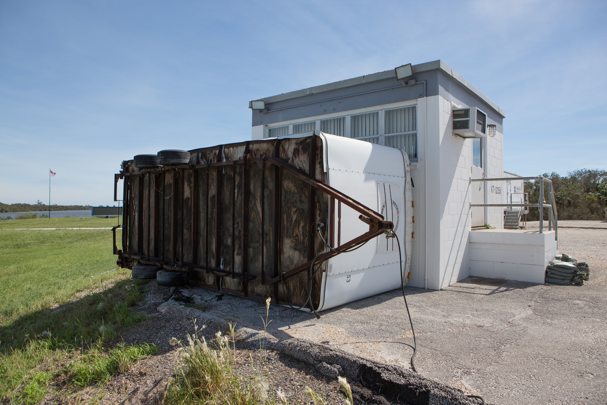 Hurricane force wind from Hurricane Matthew throw a concession stand up against the Spaceflight Now building at the LC 39 Press Site at the Kennedy Space Center in Florida on Oct. 7, 2016.  Credit: NASA/Cory Huston