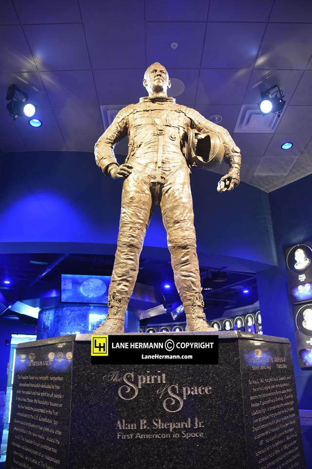 A statue of astronaut Alan Shepard, America's first person in space, stands just inside the doors to the U.S. Astronaut Hall of Fame. The exhibit is housed in a rotunda and connects the visitor to each of the astronaut inductees through state-of-the-art interactive technology.  Credit:  Lane Hermann