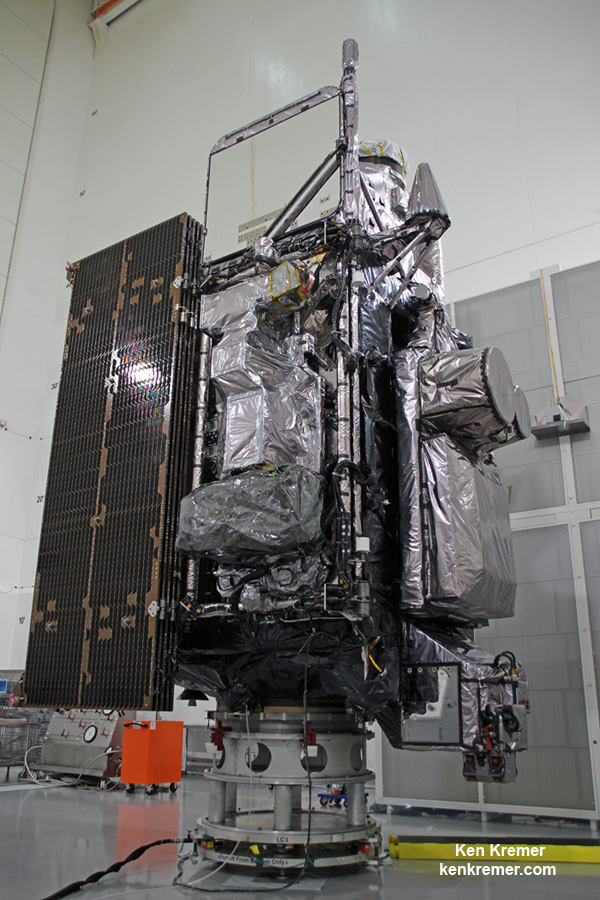 Side view of NASA/NOAA GOES-R next gen weather observation satellite showing solar panels and instruments inside Astrotech Space Operations cleanroom, in Titusville, FL. Launch is set for Nov. 19, 2016.  Credit: Ken Kremer/kenkremer.com