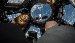 Astronauts Kate Rubins (left) and Jeff Williams (right) looking out of the ISS' cupola at a SpaceX Dragon supply spacecraft. Until recently, the effects of long-duration missions on eyesight was something of a mystery. Credit: NASA