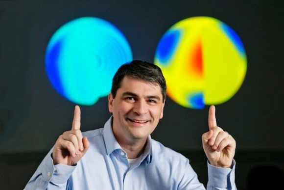 Laurent Gizon, the lead researcher of the study, pictured comparing images of our Sun and Kepler 11145123. Credit: Max Planck Institute for Solar System Research, Germany.