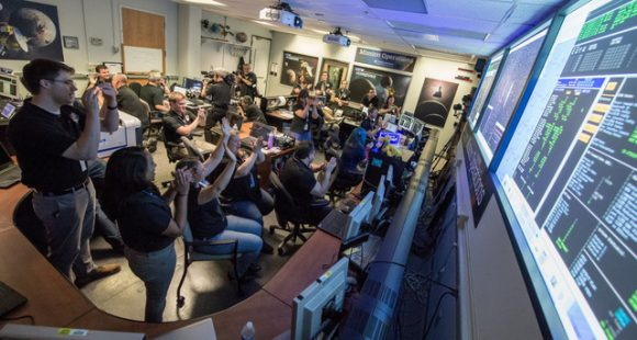 New Horizons flight controllers celebrate after they received confirmation of the spacecraft's successful flyby of Pluto on July 14, 2015. Credit: NASA/Bill Ingalls.