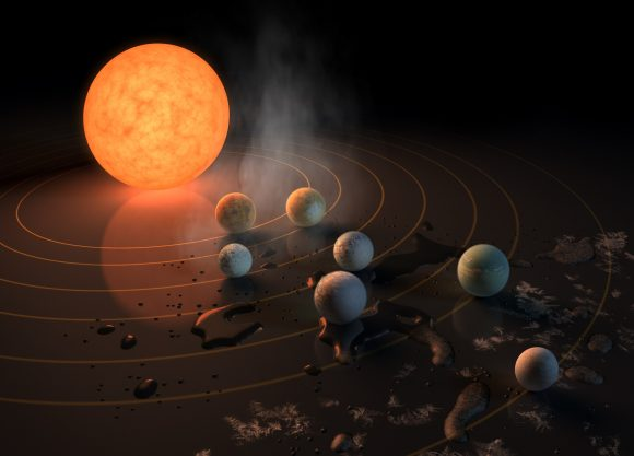 Artist's concept of the TRAPPIST-1 star system, an ultra-cool dwarf that has seven Earth-size planets orbiting it. We're going to keep finding more and more solar systemsl like this, but we need observatories like WFIRST, with starshades, to understand the planets better. Credits: NASA/JPL-Caltech