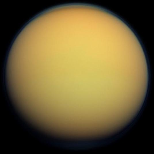 This true-color image of Titan, taken by the Cassini spacecraft, shows the moon's thick, hazy atmosphere. Though this study is mostly concerned with the atmospheres of Hot Jupiters, it also extends to other bodies with significant atmospheres, like Titan. Credit: NASA