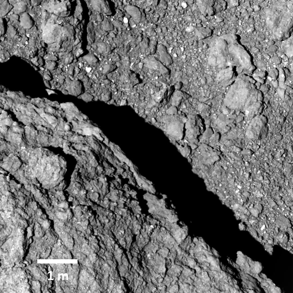 Image of Ryugu captured by the ONC-T (Optical Navigation Camera-Telescope) at an altitude of about 64m. Image was taken on September 21, 2018 at around 13:04 JST. This is the highest resolution photograph obtained of the surface of Ryugu. Bottom left is a large boulder. Credit: JAXA