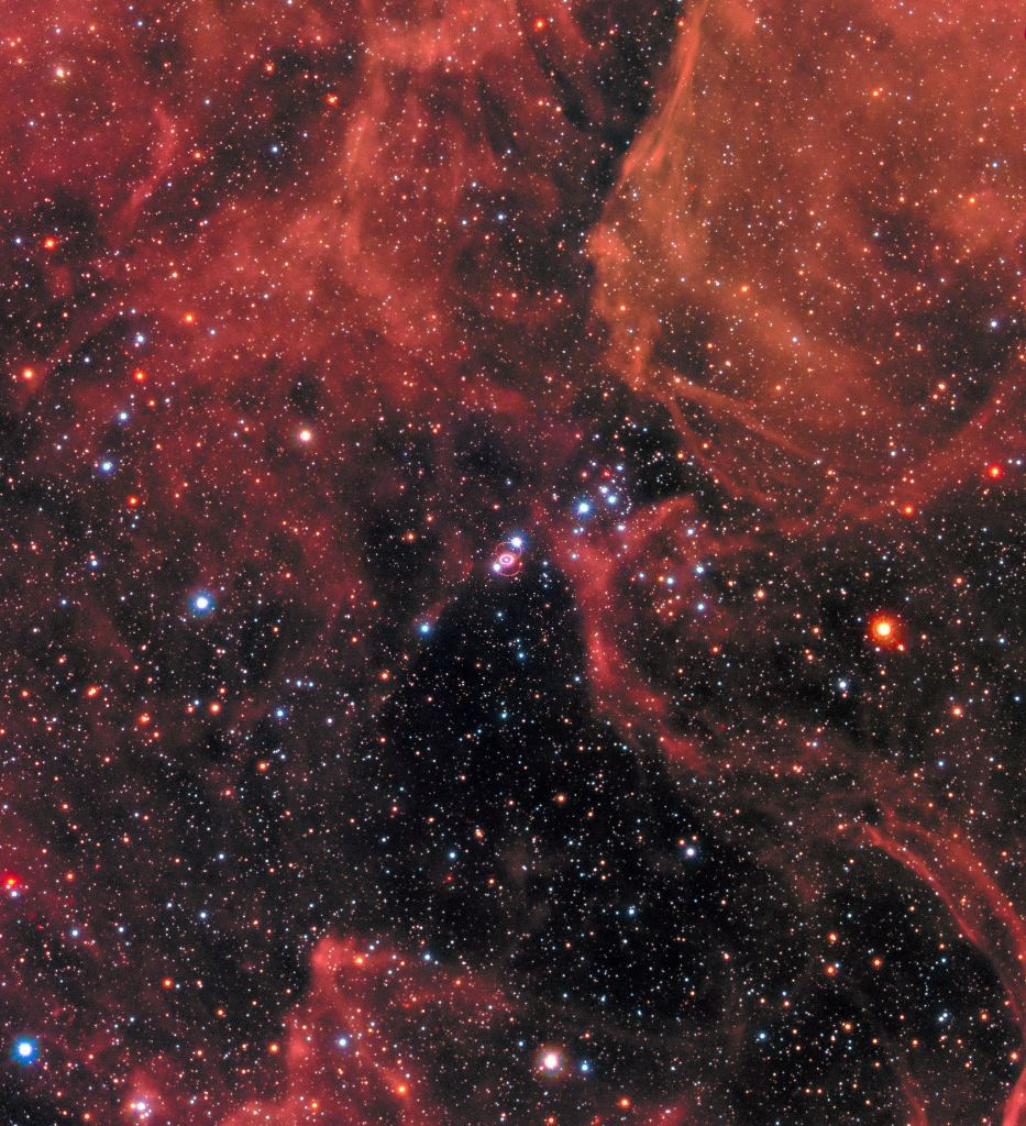This image of the supernova remnant SN 1987A was taken by the NASA/ESA Hubble Space Telescope in January 2017 using its Wide Field Camera 3 (WFC3). Since its launch in 1990 Hubble has observed the expanding dust cloud of SN 1987A several times has helped astronomers get a better understanding of these cosmic explosions. Supernova 1987A is located in the centre of the image amidst a backdrop of stars. The bright ring around the central region of the exploded star is material ejected by the star about 20 000 years before the actual explosion took place. The supernova is surrounded by gaseous clouds. The clouds' red colour represents the glow of hydrogen gas. Image Credit: NASA, ESA, and R. Kirshner (Harvard-Smithsonian Center for Astrophysics and Gordon and Betty Moore Foundation) and P. Challis (Harvard-Smithsonian Center for Astrophysics)