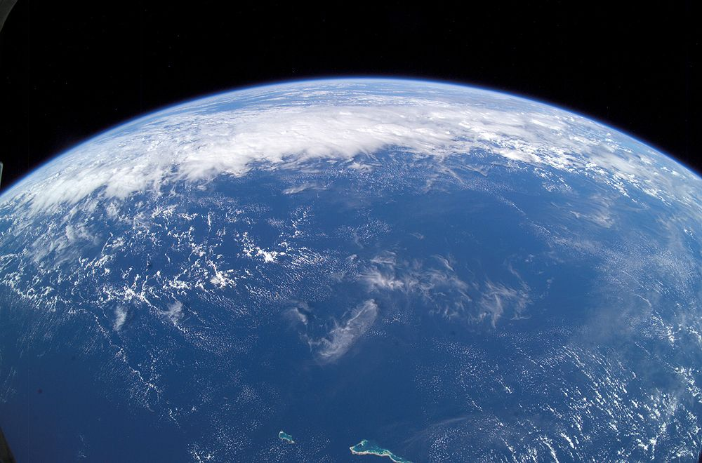 This view of Earth's horizon was taken by an Expedition 7 crewmember onboard the International Space Station, using a wide-angle lens while the Station was over the Pacific Ocean. A new study suggests that Earth's water didn't all come from comets. Credit: NASA