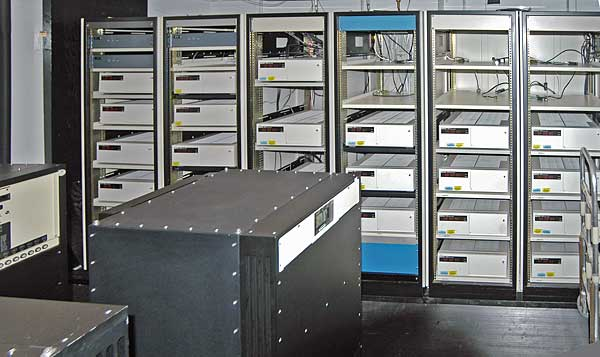 Atomic clocks have been in use for decades. This image shows banks of atomic clocks at the US Naval Observatory, used to define the time standard for the US Dept. of Defense. Image: By US Naval Observatory - http://tycho.usno.navy.mil/gif/clockvaults.jpg, Public Domain, https://commons.wikimedia.org/w/index.php?curid=5538835