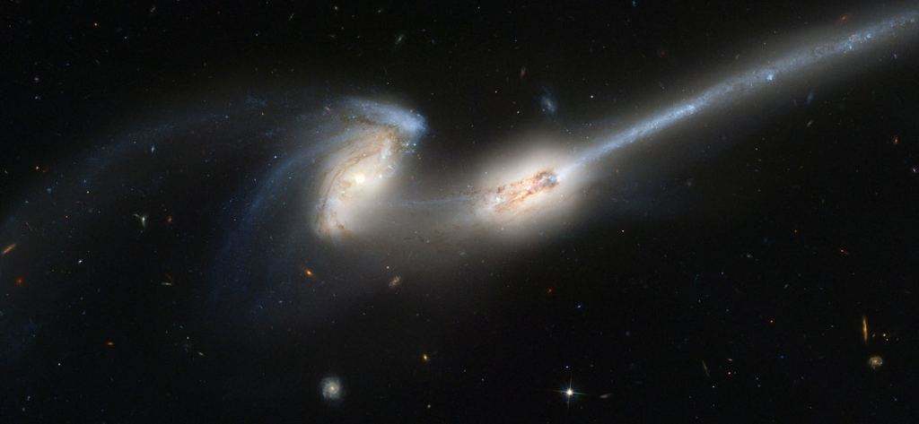 The Mice galaxies (NGC 4676 A&B) are 300 million light years away. This image of the merging pair was captured with the Hubble's Advanced Camera for Surveys (ACS.) They're nicknamed Mice because of their long streaming tails of stars, shaped by the gravitational interactions. Image Credit: By NASA, H. Ford (JHU), G. Illingworth (UCSC/LO), M.Clampin (STScI), G. Hartig (STScI), the ACS Science Team, and ESA - APOD 2004-06-12, Public Domain, https://commons.wikimedia.org/w/index.php?curid=539276