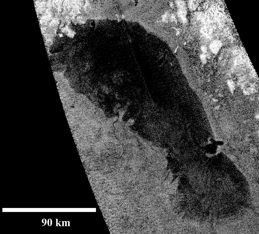 A Cassini radar image of Ontario Lacus (Lake Ontario) the first confirmed hydrocarbon on Titan. Ontario Lacus is at the moon's south polar region. Image Credit: By NASA/JPL-Caltech - http://photojournal.jpl.nasa.gov/catalog/PIA13172, Public Domain, https://commons.wikimedia.org/w/index.php?curid=10976062