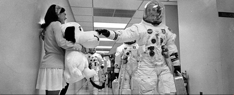 Apollo 10 commander Thomas Stafford pats a stuffed Snoopy on the snout as he heads to the launch. Image Credit: NASA.