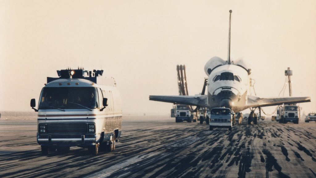 The first Astrovan with one of the Space Shuttles. Image Credit: Airstream.