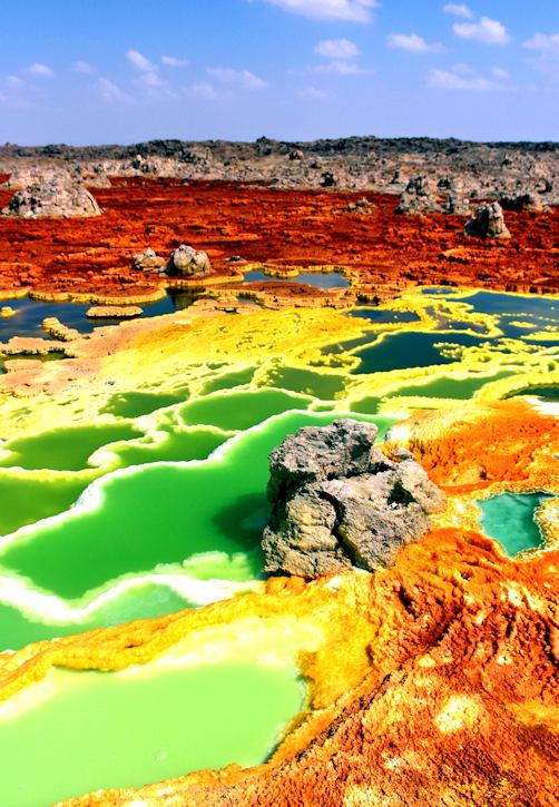 The otherworldly landscape of Dallol, Ethiopia. This is the only place on Earth where scientists have found water, but no life. Extremophiles have found a way to thrive in other extreme environments on Earth, which has generated optimism around finding life in the Solar System. Image Credit: By Kotopoulou Electra - Own work, CC BY-SA 4.0, https://commons.wikimedia.org/w/index.php?curid=74975209