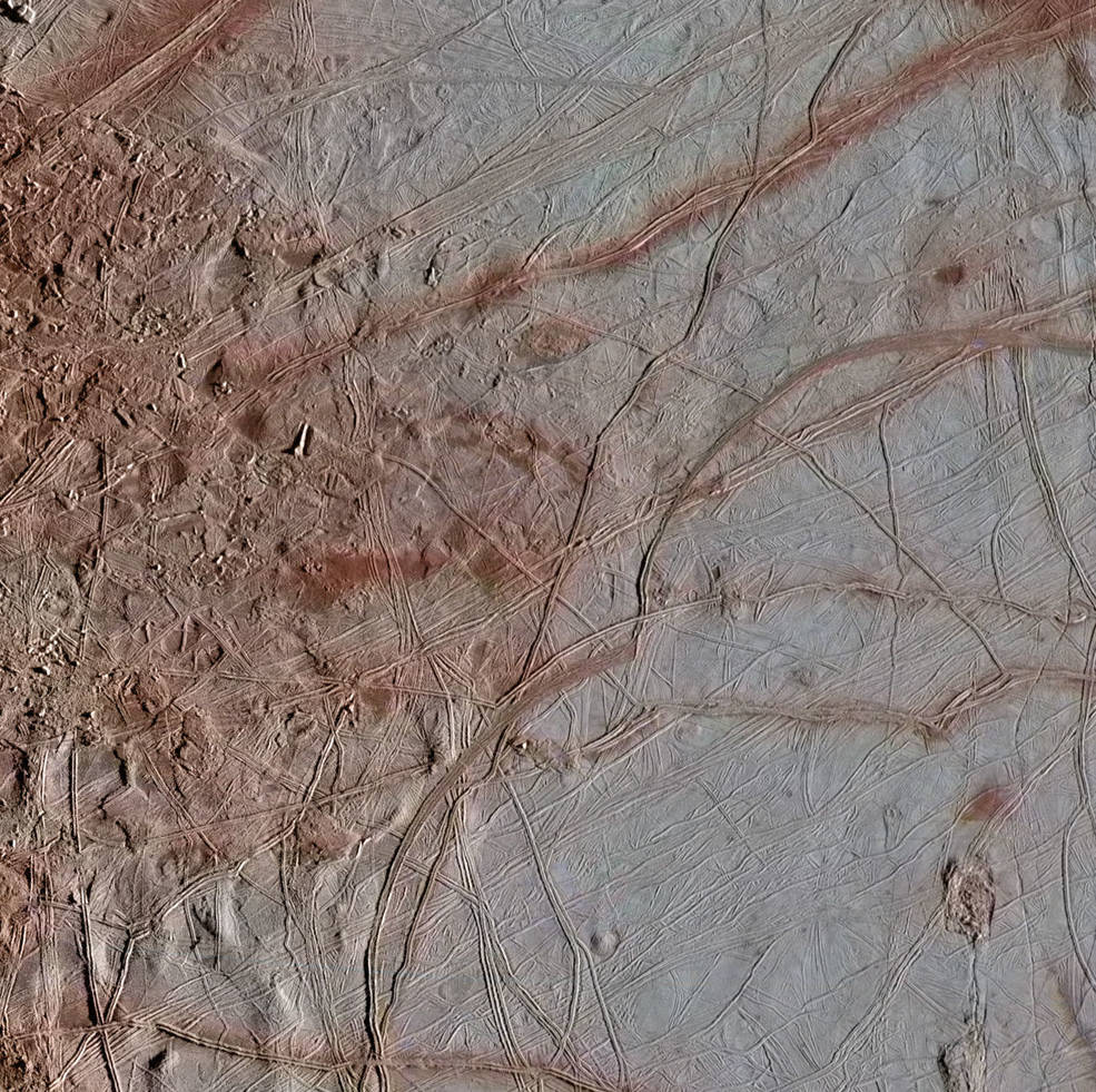 Newly re-processed Galileo images of Europa's surface show details that are visible in the variety of features on the moon's icy surface. This image of an area called Chaos Transition shows blocks that have moved and ridges possibly related to how the crust fractures from the force of Jupiter's gravity. Image Credit: NASA/JPL-Caltech/SETI Institute