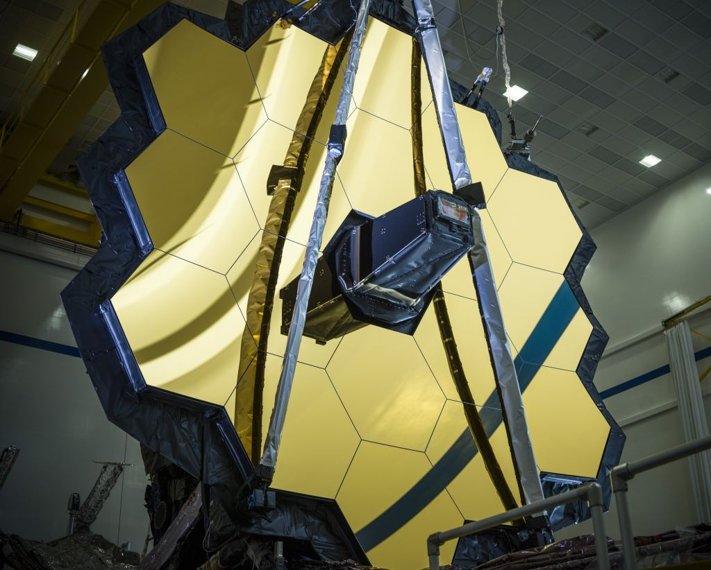 Shown with its primary mirror fully deployed, NASA's James Webb Space Telescope is the largest and most technically complex space science telescope NASA has ever built. One day, hopefully soon, it'll finally launch. Credit: NASA/Chris Gunn