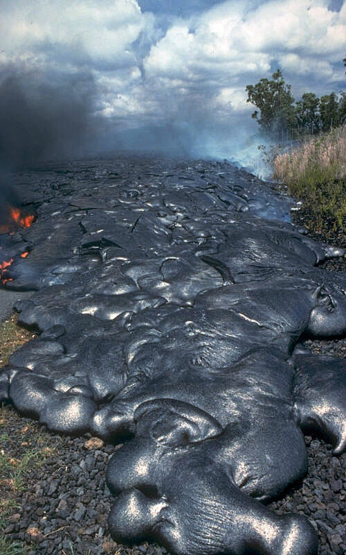 Lava from Hawaii's K?lauea Volcano moving across a road. When lava solidifies, it can retain evidence of the Earth's magnetic field. Image Credit: By J.D. Griggs, USGS - Archived source link, Public Domain, https://commons.wikimedia.org/w/index.php?curid=18042